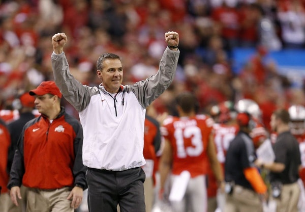 Ohio State head coach Urban Meyer reacts to a late touchdown during a 59-0 win against Wisconsin in the 2014 Big Ten championship game at Lucas Oil St