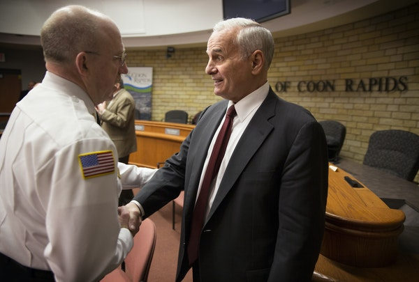 Gov. Mark Dayton spoke with Coon Rapids Fire Chief John Piper after the meeting held Monday to address the issue of trains disturbing traffic flow.