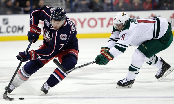 The Wild's Zach Parise, right, tried to steal the puck from the Blue Jackets' Jack Johnson during the second period Wednesday.