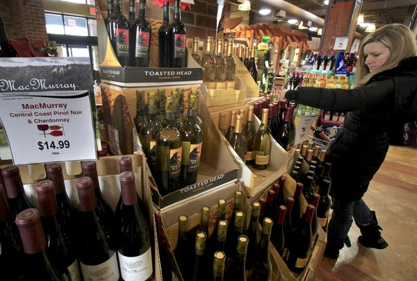 Minnesota's municipal liquor stores' profits stalled and contributions to city coffers dropped considerably last year as several outstate operatio