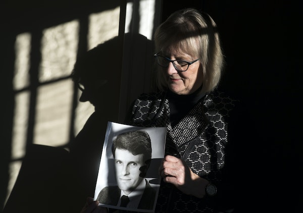 Patty Paulus holds a portrait of her late husband, Stephen Paulus, in their St. Paul home. He is nominated for a Grammy for his Concerto for Two Trump