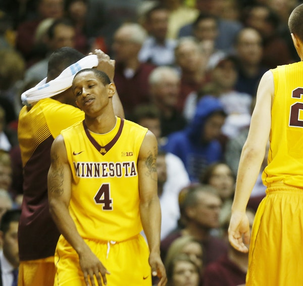 """Dejected Gophers guard DeAndre Mathieu reacted to the officials' ruling Tuesday that he got off his final shot a smidge too late. """"It doesn't se"""