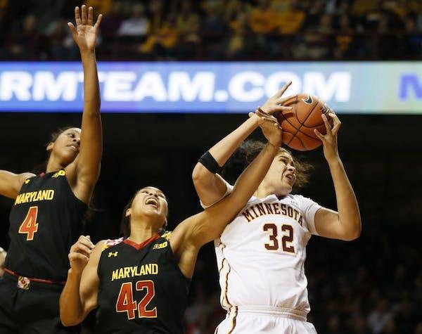 Minnesota Golden Gophers center Amanda Zahui B. (32) pulled down a rebound over Maryland Terrapins center Brionna Jones (42) Sunday at Williams arena