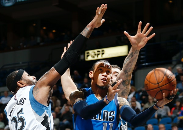Monta Ellis (11) attempted a shot while being defended by Mo Williams (25) and Nikola Pekovic (14) in the third quarter.