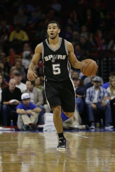 San Antonio Spurs' Cory Joseph in action during an NBA basketball game against the Philadelphia 76ers, Monday, Dec. 1, 2014, in Philadelphia. (AP Phot