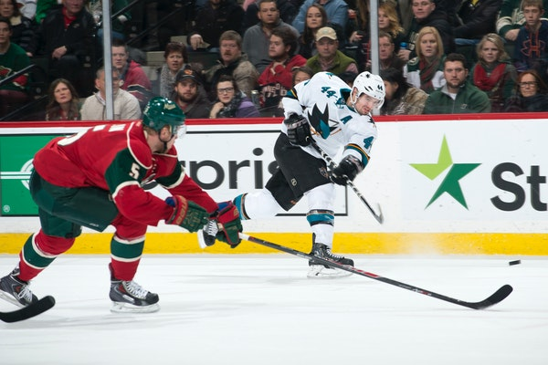 San Jose Sharks defenseman Marc-Edouard Vlasic (44) gets off a shot while being defended by Minnesota Wild defenseman Christian Folin (5) in the final