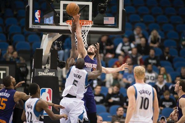 Phoenix Suns center Miles Plumlee (22) blocks a shot by Minnesota Timberwolves center Gorgui Dieng (5) during the second quarter.
