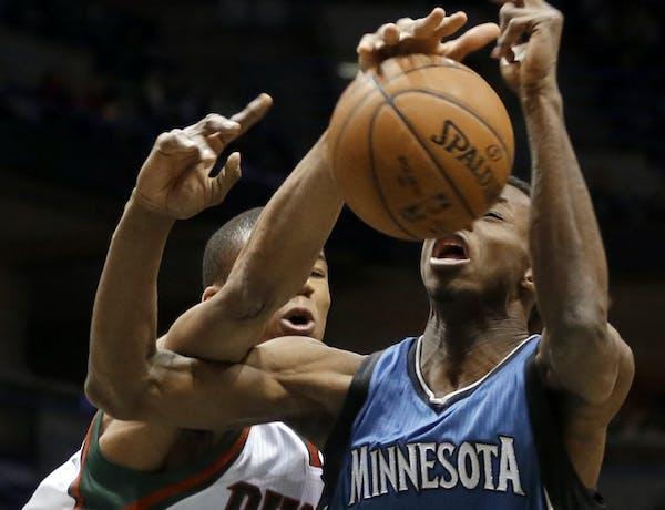 Milwaukee Bucks' Giannis Antetokounmpo fouls Minnesota Timberwolves' Andrew Wiggins during the first half of an NBA basketball game Friday, Jan. 9