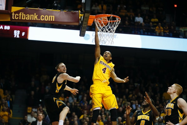 Minnesota Gophers guard DeAndre Mathieu (4) put up a shot on the Iowa defense with not time on the clock Tuesday at Williams Arena. The Gophers lost 7