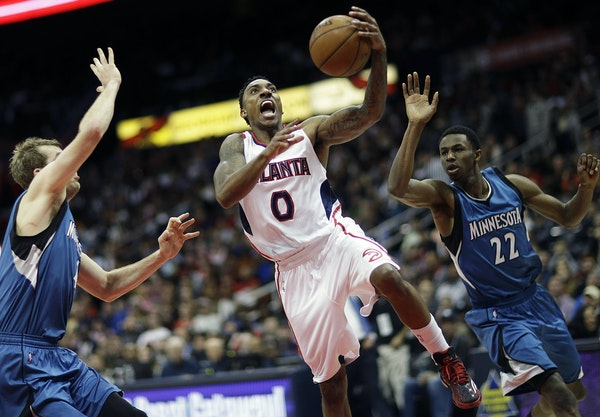 Point guard Jeff Teague, who split Wolves defenders Robbie Hummel, left, and Andrew Wiggins, averages a team-high but modest 17.1 points.