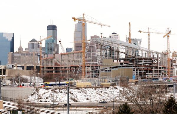 Construction of Vikings stadium in downtown Minneapolis is seen from the Cedar-Riverside neighborhood on Friday, January 2, 2015.