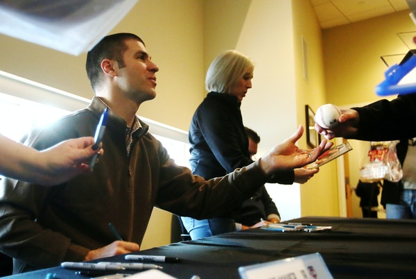 Joe Mauer, signing autographs at TwinsFest on Friday, will try to rebound from a 2014 season in which he batted a career-low .277.