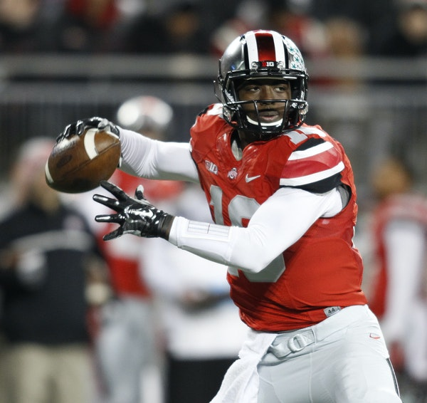 Ohio State quarterback J.T. Barrett drops back to pass against Illinois during the first quarter of an NCAA college football game Saturday, Nov. 1, 20