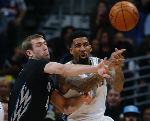 Wolves forward Robbie Hummel, left, deflected a pass for Nuggets forward Wilson Chandler on Saturday night. Hummel had a double-double with 15 points