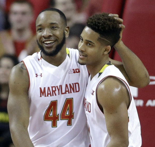 Dez Wells, left, and Melo Trimble have nationally ranked Maryland in the thick of its first Big Ten championship race.