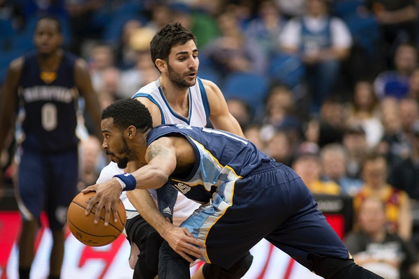 Minnesota Timberwolves guard Ricky Rubio (9) defends against Memphis Grizzlies guard Mike Conley (11) during the second quarter.
