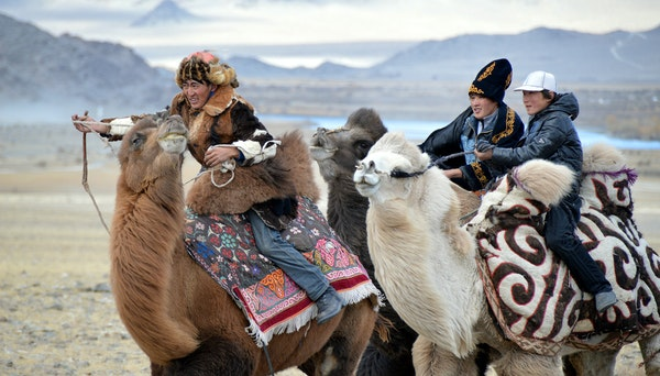Three participants in the camel race in the games at the Eagle Hunting Festival in Ulgii, Mongolia, in October 2014.