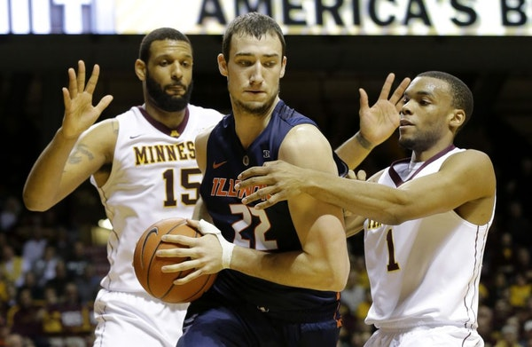 Illinois center Maverick Morgan (22) is trapped by Minnesota forward Maurice Walker (15) and guard Andre Hollins (1) during the first half of an NCAA
