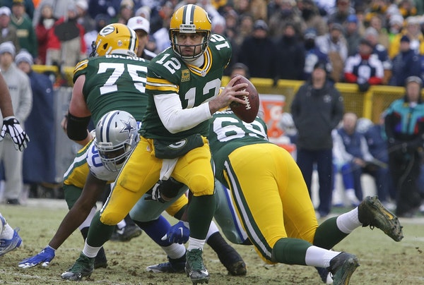 Limited in his ability to scramble because of a torn calf muscle, Packers quarterback Aaron Rodgers dissected the Cowboys with toughness and precision