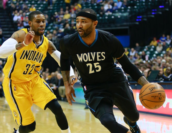 Timberwolves guard Mo Williams dribbled against Pacers guard C.J. Watson in the first half Tuesday. Williams scored a franchise-record 52 points to sp