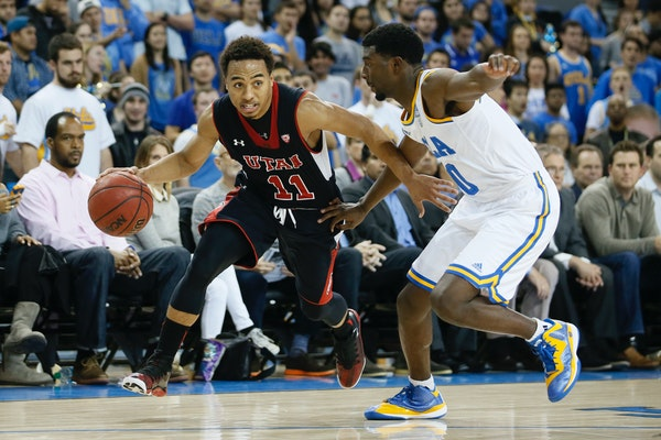 Utah's Brandon Taylor, left, dribbles as UCLA's Isaac Hamilton, right, defends him during the first half of an NCAA college basketball game Thursday,