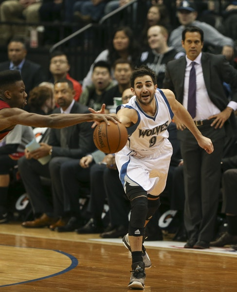 Miami Heat guard Norris Cole beat Timberwolves guard Ricky Rubio to a loose ball in the second quarter Wednesday night at Target Center. ] JEFF WHEELE