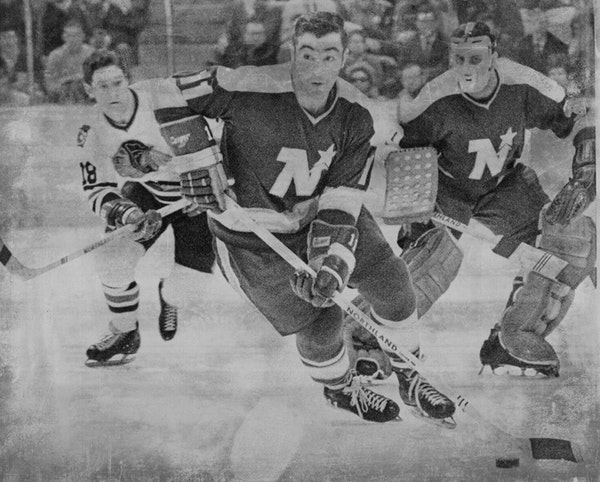 Parise is action against Chicago in 1970. The Blackhawks player is Gerry Pinder.