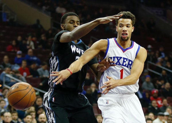 The Philadelphia 76ers' Michael Carter-Williams passes around the Minnesota Timberwolves' Andrew Wiggins during the first quarter at the Wells Fargo C