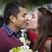Fabian Lopez and Erika Farrell leaned in for a kiss as they waited to get married on Friday, February 13, 2015 at the Government Center in Minneapolis