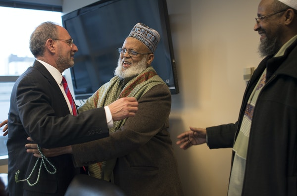 Imam Sheikh Sa'ad Musse Roble, alongside Imam Ahmed Burale (right), had a warm greeting for U.S. Attorney Andy Luger before a Somali community meeti