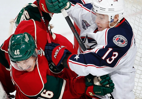 The Wild's Jared Spurgeon, left, and Columbus' Cam Atkinson fought for position in front of the Wild goal during the third period Monday night.