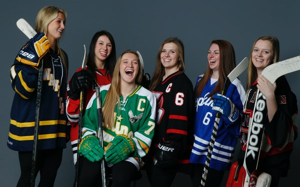 Player of the Year Taylor Williamson (No. 7 in green) of Edina held court with the rest of the Star Tribune Girls' Hockey All-Metro first team. They