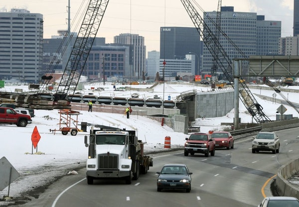 FILE - In this Dec. 2, 2014, file photo, construction continues on Interstate 35E in St. Paul. Minnesota has the nation's fifth-largest highway syst