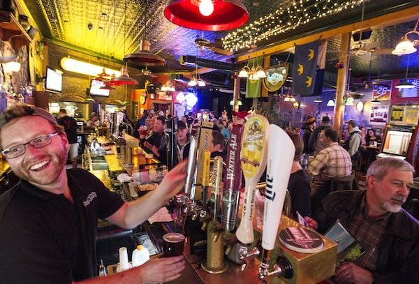 Bartender George Huss happily serves customers at Shamrock's in St. Paul's West 7th neighborhood.