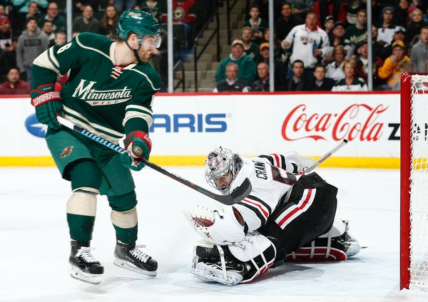Jason Zucker (16) shot the puck past Chicago goalie Corey Crawford (50) for a goal in the first period.