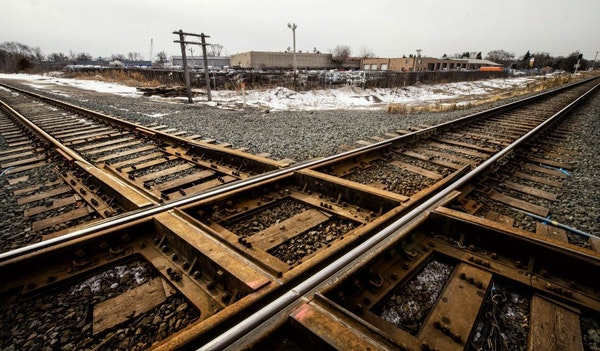 Burlington Northern Santa Fe and Canadian Pacific plan to create a connection here between their intersecting tracks in Crystal. The move could affect