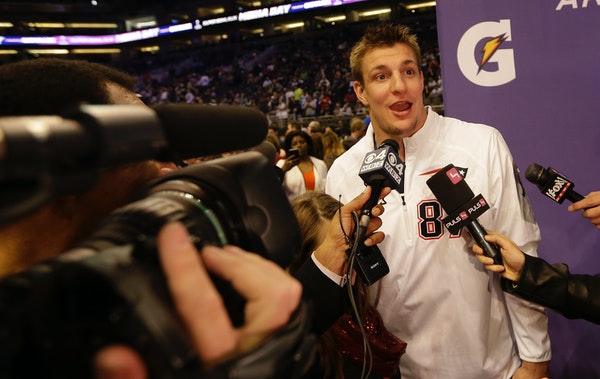 New England Patriots' Rob Gronkowski answers questions during media day for NFL Super Bowl XLIX football game Tuesday, Jan. 27, 2015, in Phoenix. (AP