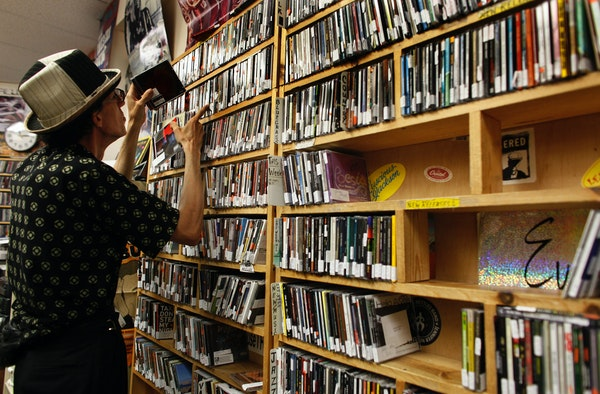 Host and volunteer Elmar Romain cataloged CDs back in 2009 at KFAI-FM's studios in Minneapolis' Cedar-Riverside area.