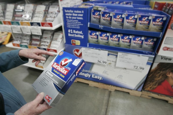 FILE - In this Wednesday, March 5, 2008, file photo. a Costco shopper purchases TurboTax at Costco in Mountain View, Calif.