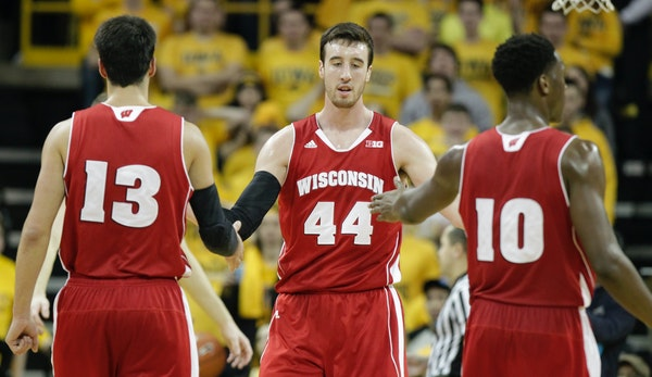 Wisconsin's Frank Kaminsky (44) is congratulated by teammates Duje Dukan (13) and Nigel Hayes (10) after drawing a goal against Iowa's Adam Woodbury d