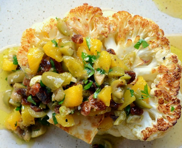 Cauliflower steaks can be topped with everything from an olive pistou to marinara sauce and mozzarella cheese.
