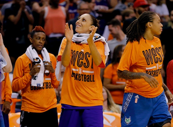 West's Diana Taurasi, of the Phoenix Mercury, applauds as time expires after the WNBA All-Star basketball game, Saturday, July 19, 2014, in Phoenix. T