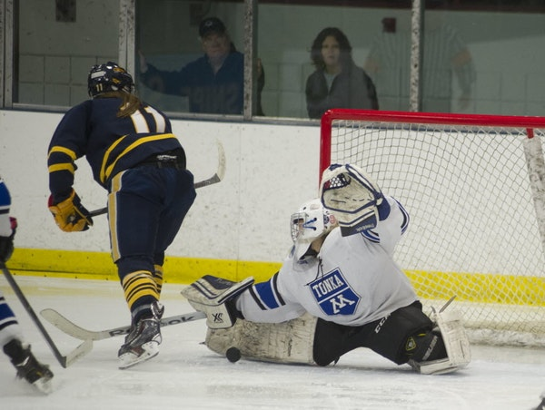 Minnetonka goalie Taty Delaittre makes a save on a shot from Wayzata's Izzy Shannon during the third period of Friday night's game at the Parade Ice G