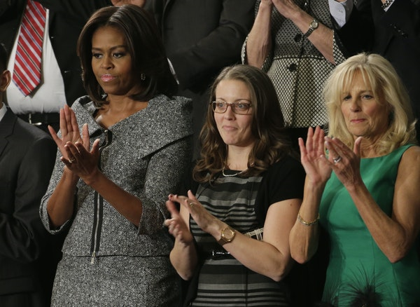 Rebekah Erler, center, with First Lady Michelle Obama.
