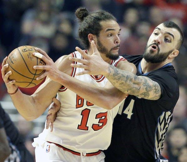 Chicago Bulls center Joakim Noah (13) looks to a pass as Minnesota Timberwolves center Nikola Pekovic (14) guards during the first half of an NBA bask