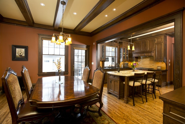 The wall separating the dining room and the kitchen was removed, creating a more open floor plan. But the overall aesthetic remains traditional. Archi