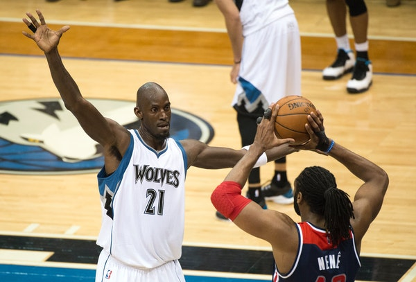 Kevin Garnett (21) guards an inbound bass by Washington Wizards forward Nene Hilario (42) during the second quarter of Wednesday night's game.