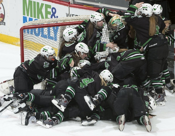 Hill-Murray players piled on top of one another in celebrating back-to-back Class 2A girls' hockey championships, this one earned with a 2-1 victory