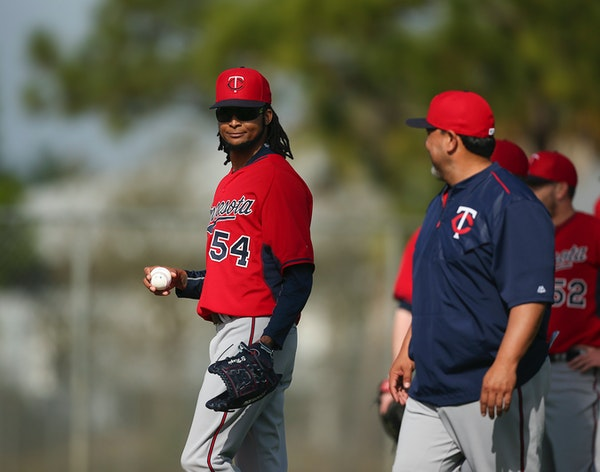 The Twins' Ervin Santana smiled at coach Eddie Guardado before he and some other pitchers started a drill Tuesday morning at Hammond Stadium.