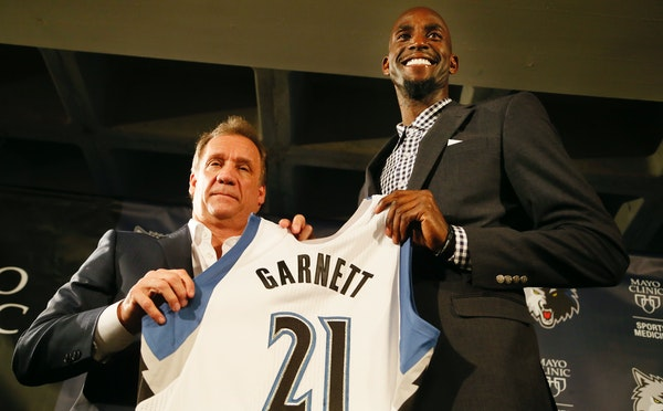Timberwolves coach Flip Saunders left and Kevin Garnett posed for a photo after he was introduced to the Twins Cities media at Target Center Tuesday F